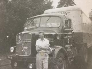 Benny Looze in front of old truck